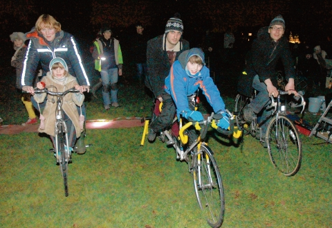 Outdoor cinema screening powered by people on bikes, on New Year's Day at King George V field, Wivenhoe. Sarah Haydar and Faiza, Lee Ashcroft and Chris Ellis.