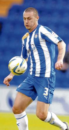 Exit - defender Michael Rose has had his contract cancelled by Colchester United.