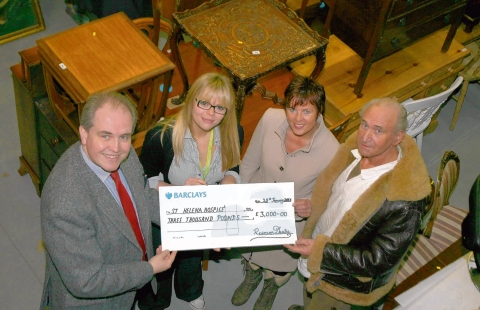 Reeman Dansie auction house raised £3,000 in a charity auction for St Helena Hospice. James Grinter (left) presents cheque to Sophie Harvey from the charity along with Dave Ross and Jackie Gould who also helped raise the money.