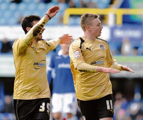 Spot on - Freddie Sears celebrates with George Porter after scoring a penalty for Colchester United in their 3-2 win over Portsmouth. Picture: WARREN PAGE