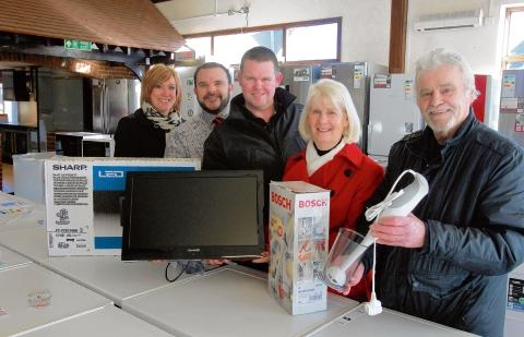 Stellisons manager Matt Turner & Karen Mole, Gazette promotions, presenting televisions to Cindy Baker and David Lawrence, with Tony Davey who won a blender.