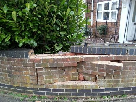 Tenant returns to find garden wall demolished