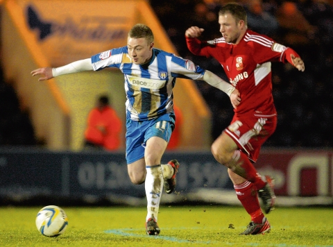 Drive - Freddie Sears attacks the Swindon Town defence during Colchester's 1-0 defeat. Picture: SEANA HUGHES (CO74614-21)