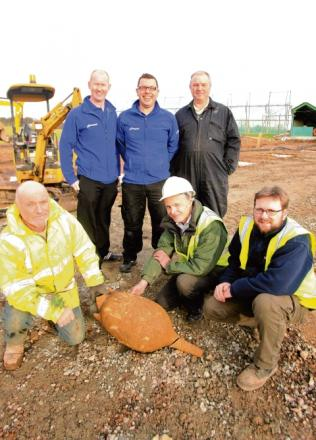 Colchester Archaelogical Trust have found an Iron Age burial site at Playgolf Colchester Don Shimmin & Chris Lister (right) from the Trust with Anthony Kirwan, Chris Clancy & Mark Easterbrook from the club and builder Phillip Hughes who found it.
