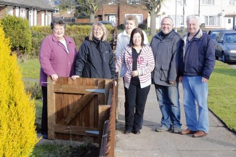 Gazette: Residents and councillors celebrate a new fence: (from left) Marion Swalwell, Cllr Julie Young, Susan Tiffin, Maureen Harvey, Cllr Tim Young, Billy Tiffin and the fence