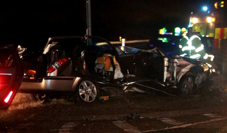 Firefighters cut crash victim out of car