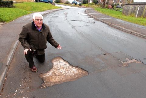 Steve Tasker highlights some of the problems in Valley Road, Wivenhoe.