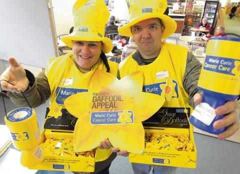 Sarah and Philip Perkins all dressed up and ready to get collecting for Marie Curie from base camp in Colchester library.