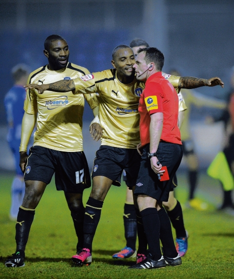 Protests - Jabo Ibehre, along with U's team-mate Clinton Morrison, protest to referee Geoff Eltringham after the former MK Dons striker was sent off at Hartlepool United. Picture: RICHARD BLAXALL