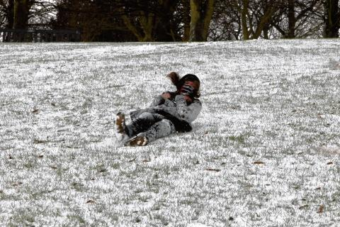 A youngster makes the most of the snow in Castle Park.