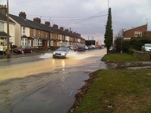 Braintree: Burst main turns Rayne Road into a river