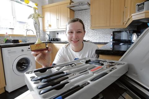 Sous chef Charlie Johnson with her Goscar and tools of the trade.