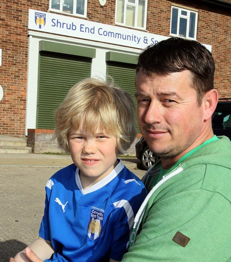 Stuart Richards with son Zane, eight, at the training centre in Shrub End, Colchester.