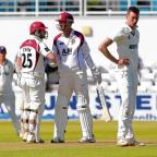 n Joy and pain – Northants' Trent Copeland is congratulated on half-century by fellow batsman Steven Crook, much to the frustration of Essex bowler Reece Topley, right