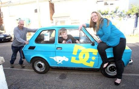 Gazette: Carolina Bailey with son Oscar, ten, and boyfriend Andrew Cullington, are driving across Europe to raise money in memory of her late mum, Marie