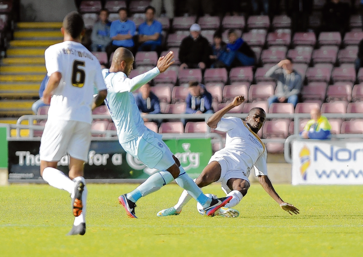 Great example - Tosin Olufemi challenges Coventry City's Jordan Clarke during Colchester United's 2-0 defeat at the hands of the Sky Blues on Sunday. Picture: WARREN PAGE