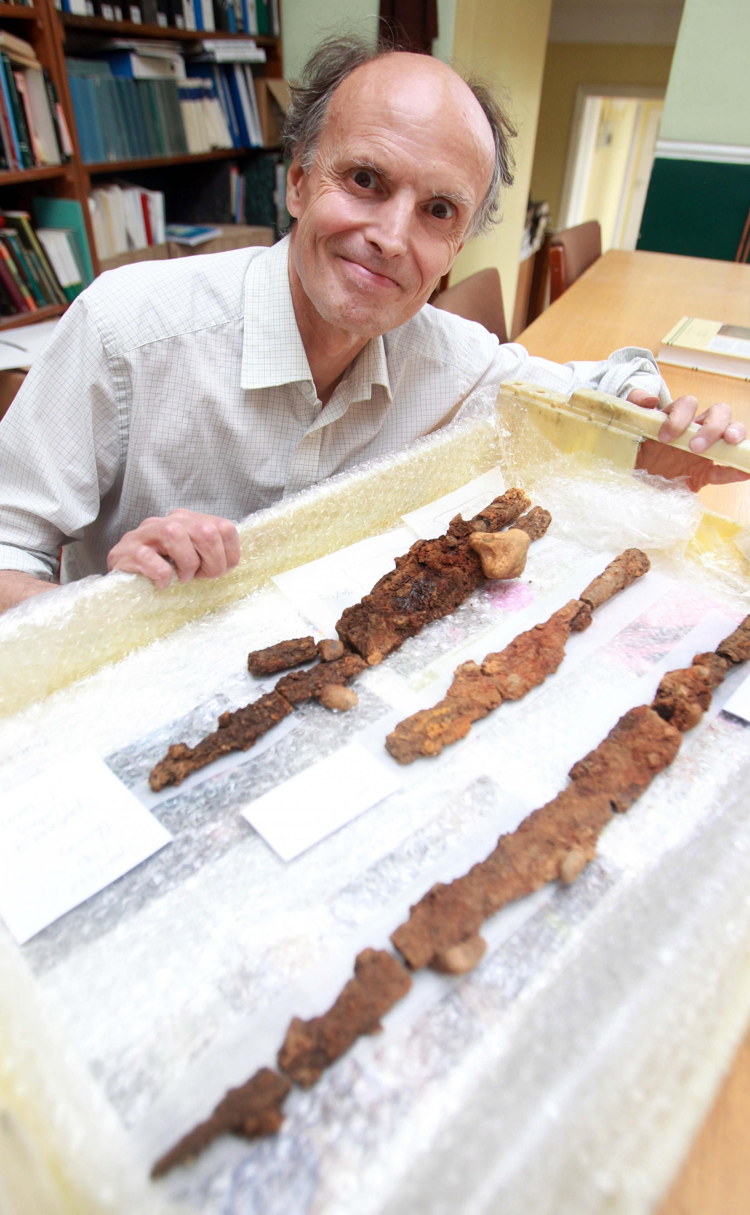 Don Shimmin with some of the spears found in the warrior grave