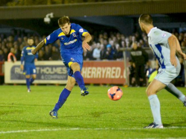 Hot shot - Harry Pell, pictured playing for AFC Wimbledon, is reportedly interesting Colchester United