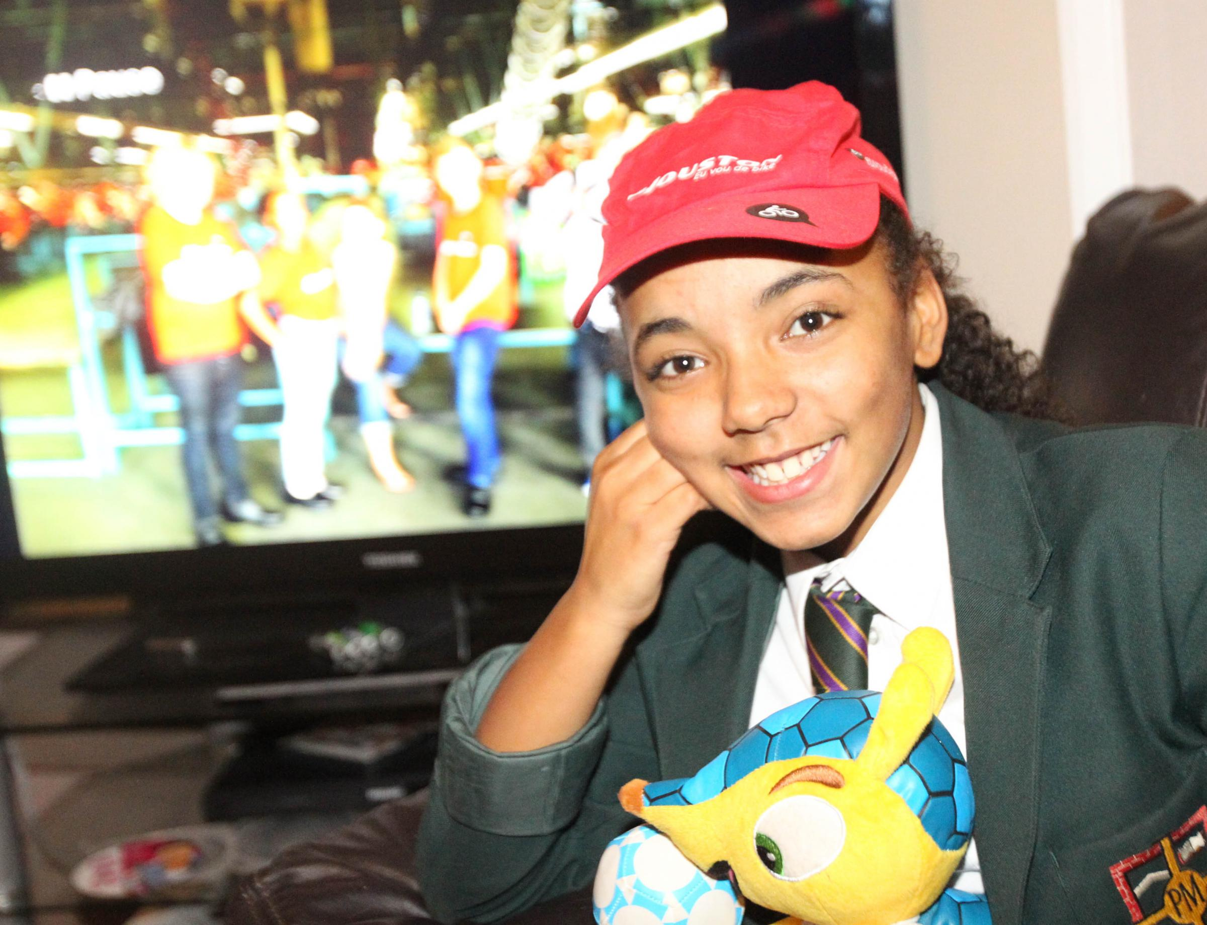 Kassia Wall, 12, prepares to watch the first episode of her trip to Brazil.