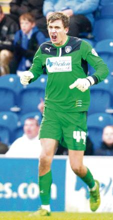 Staying put - goalkeeper Sam Walker has signed a permanent deal with Colchester United following two successful loan spells.