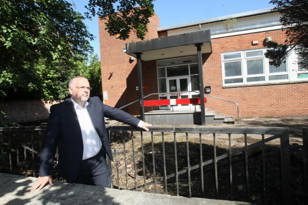 "Gazette: Frustrating – councillor Tim Young outside the ""eyesore"" Royal Mail depot due to make way for a Premier Inn"