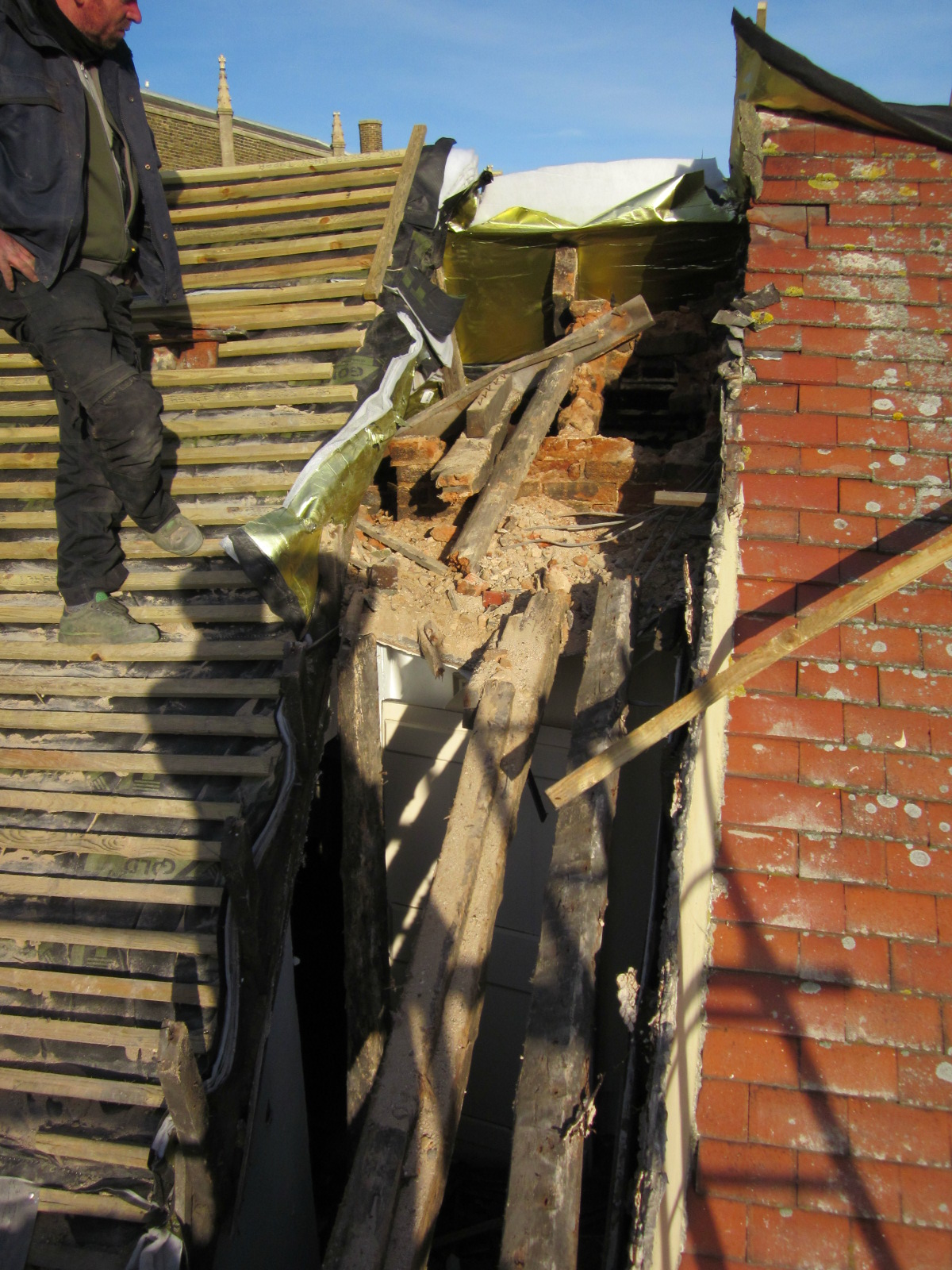 Chimney stacfk collapses at town's oldest house