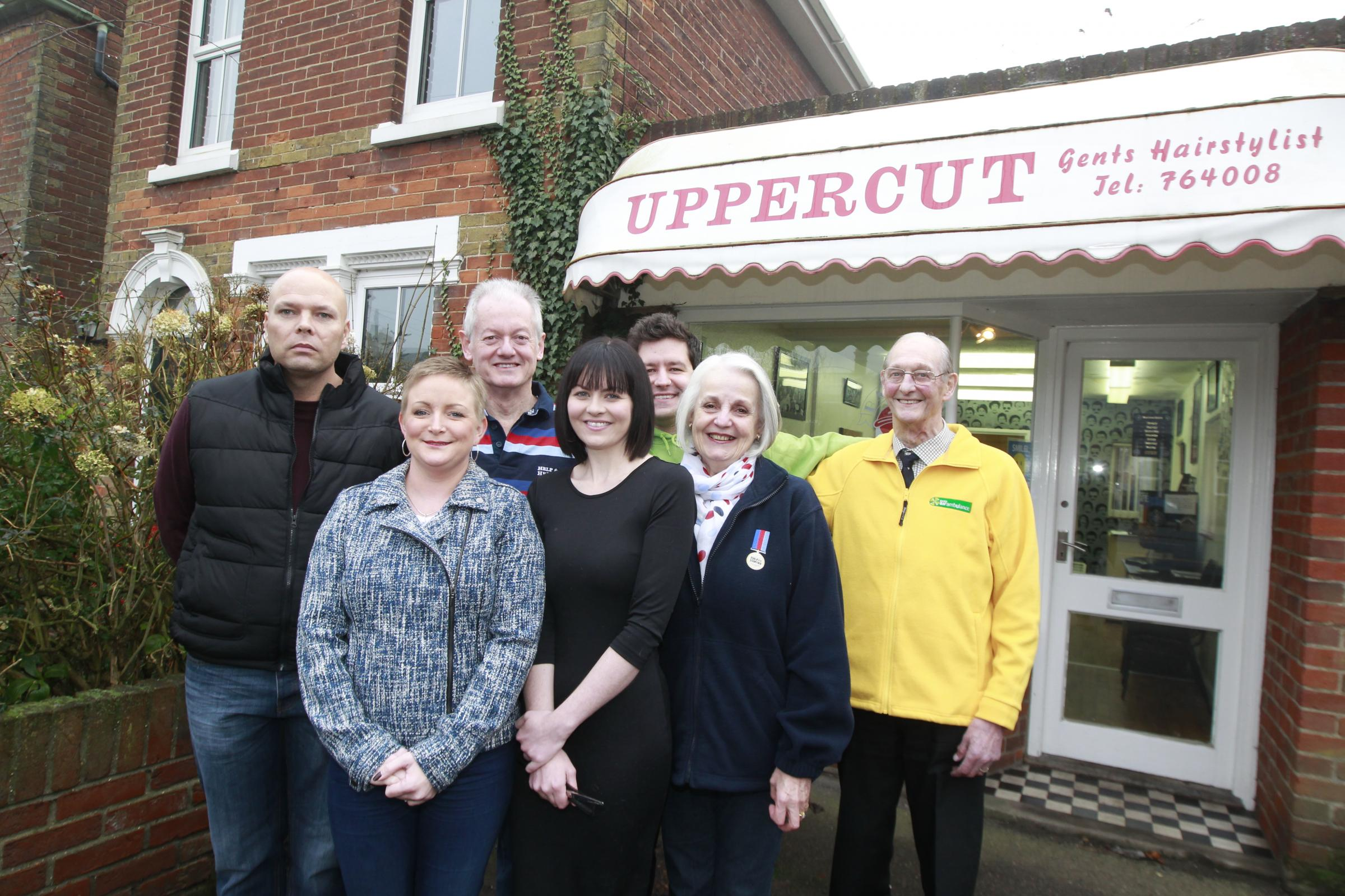 Crime-hit barbers give £2,500 to charities