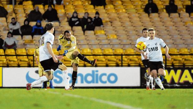 Trying his luck - U's attacker Dominic Vose attempts a shot during his side's 2-0 defeat at Port Vale. Picture: WARREN PAGE