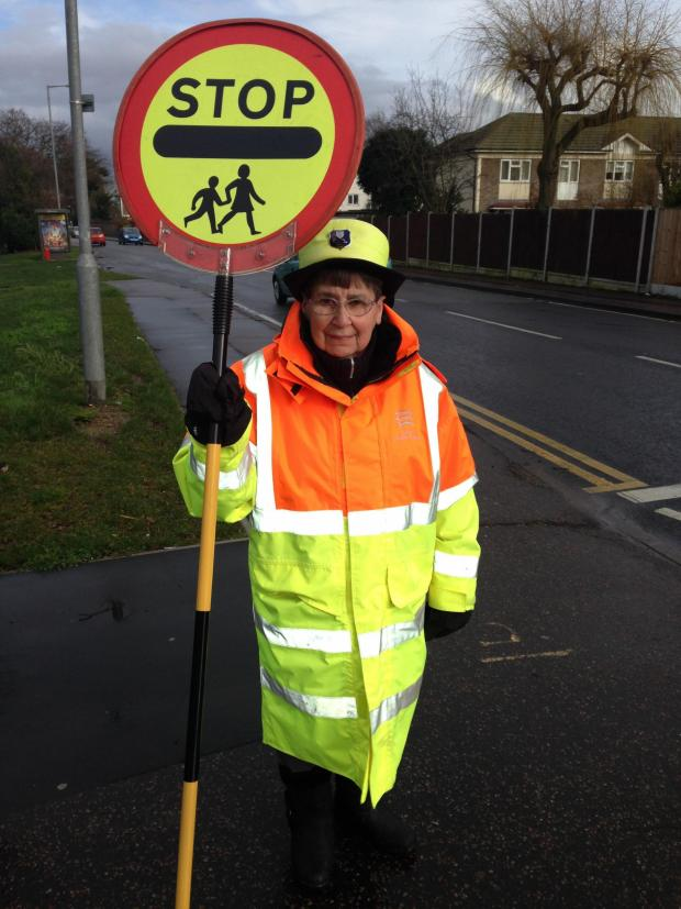 Gazette: A lollipop lady at Cherry Tree Primary School