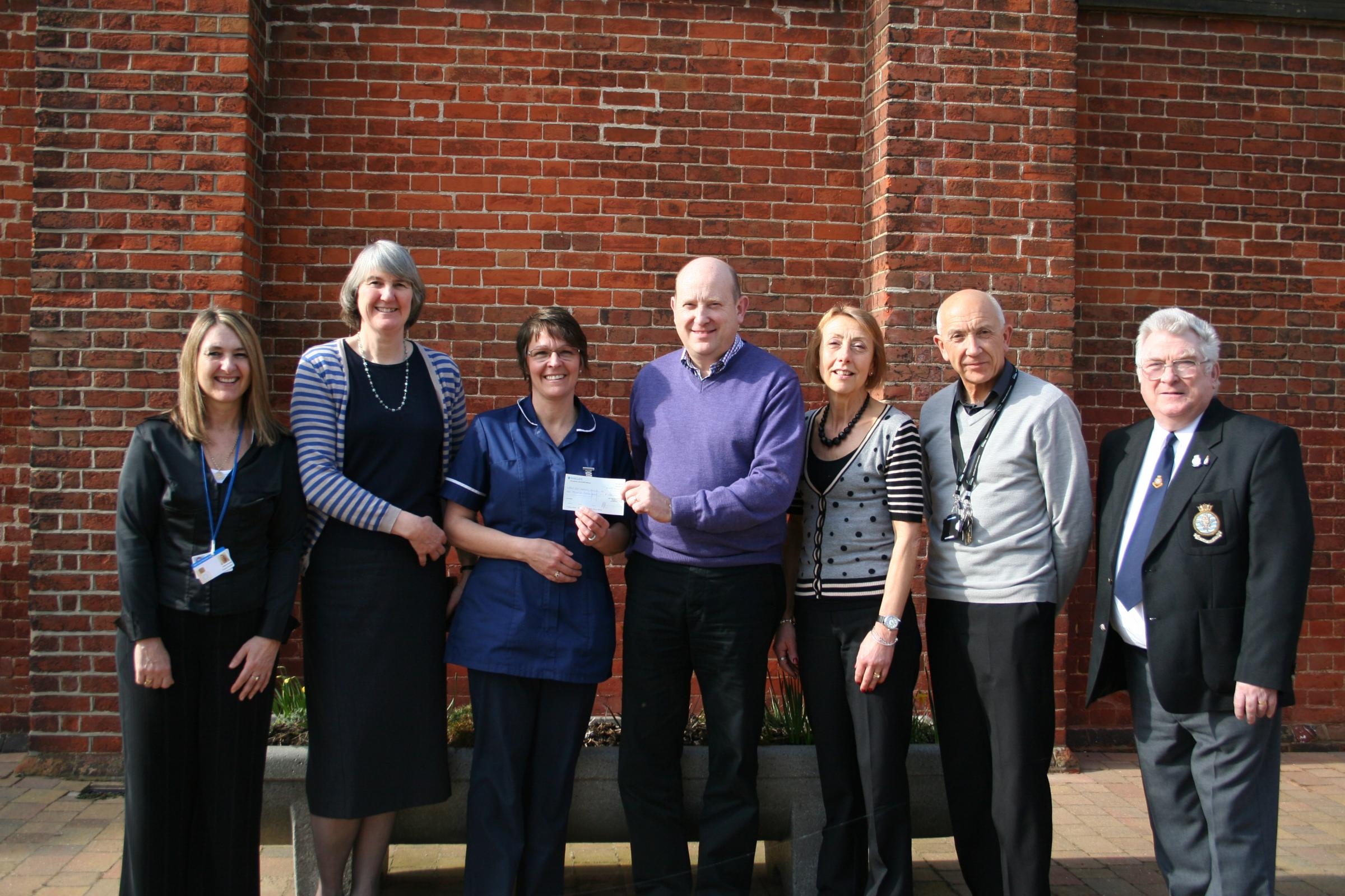 Members of the Creffield Medical Centre present a cheque to Help for Heroes