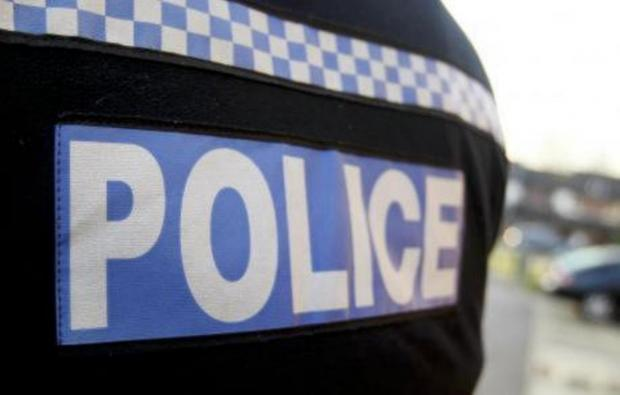 Police flood estate after woman discovers burglar