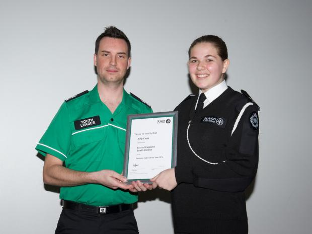 Winner – Amy Cook receives her award from Dave Christophers, St John Ambulance national young people adviser. Picture: BRIAN ALDRICH