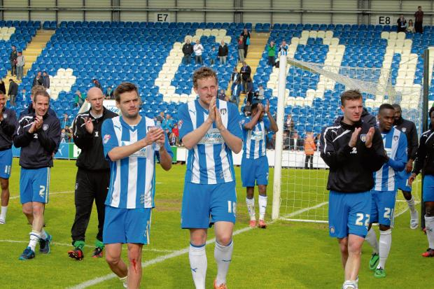 Plenty to celebrate - Colchester United's players thank the club's supporters following their final home game of the season, last weekend. Picture: NIGEL BROWN (CO90950-25)