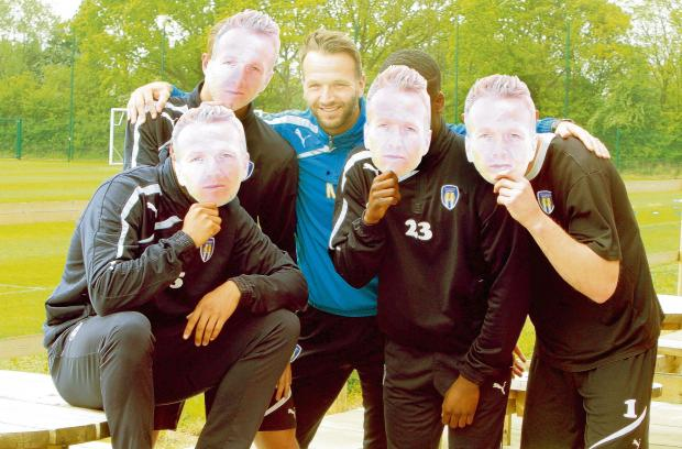 Gazette: Face of a legend - U's player-coach Karl Duguid with his team-mates showing off the masks we will be printing in Friday's Daily Gazette, ahead of his final-ever game as a player. Picture: ADRIAN RUSHTON (CO93717-43)
