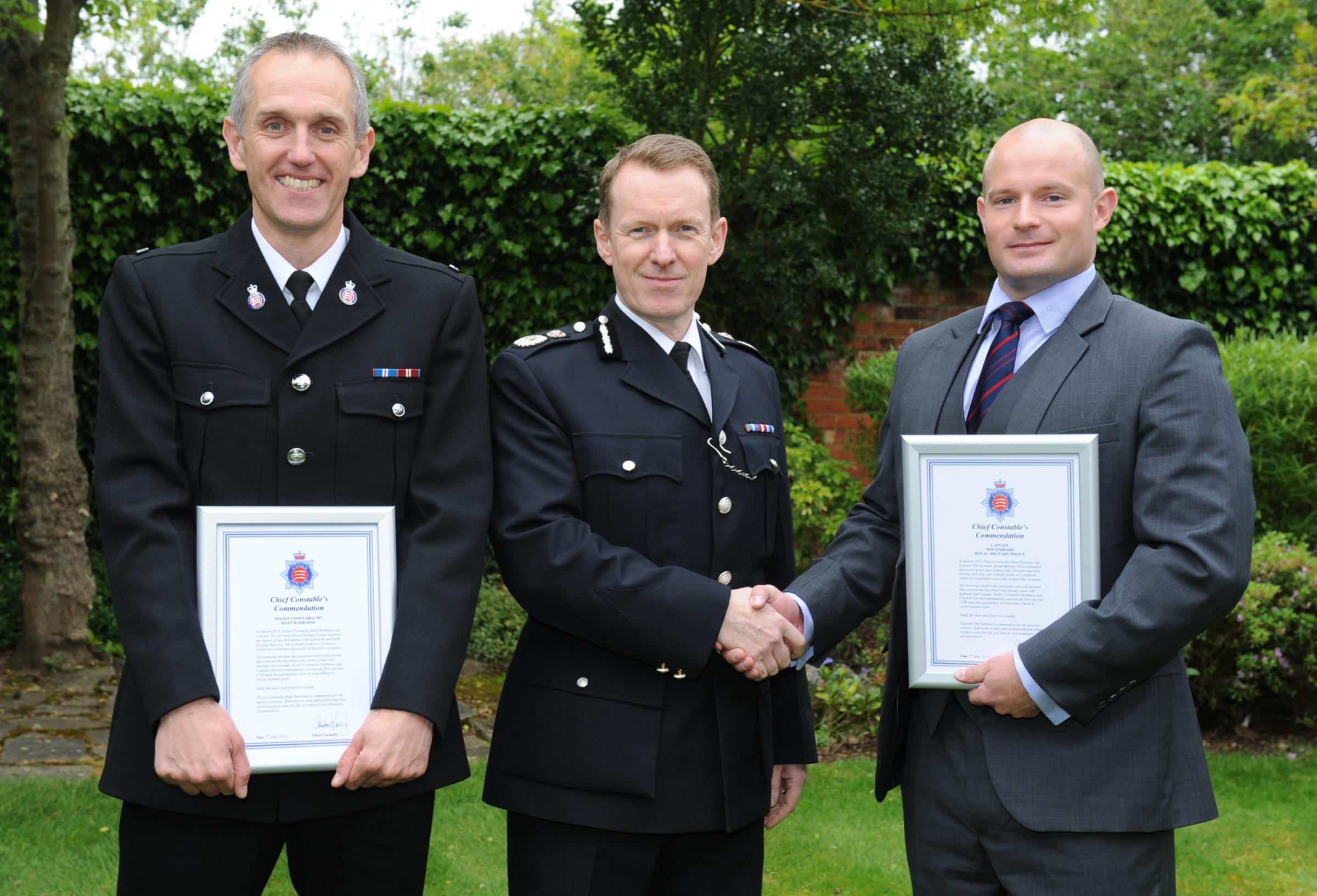 Congratulations – Chief Constable Stephen Kavanagh, centre, with PC Matt Harkness, left, and Captain Tim Gerrard