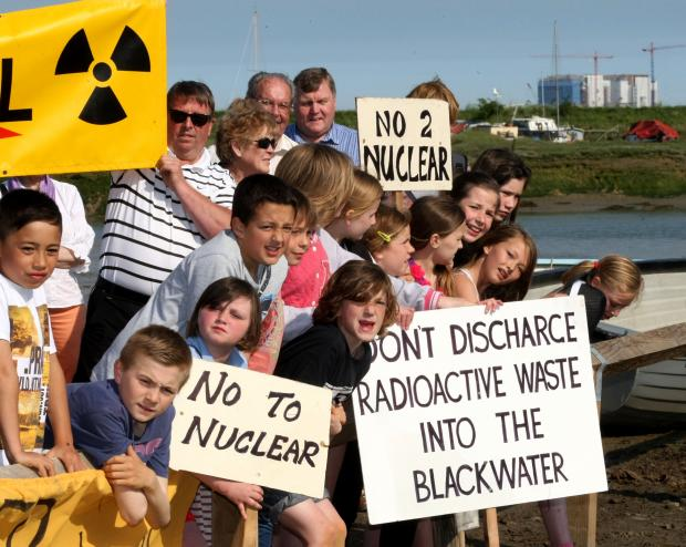Protesters at Tollesbury, with Bradwell Power Station in the background