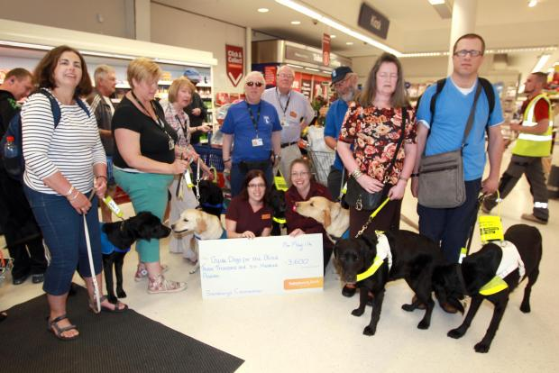 Guide Dogs given thousands of pounds by shop staff