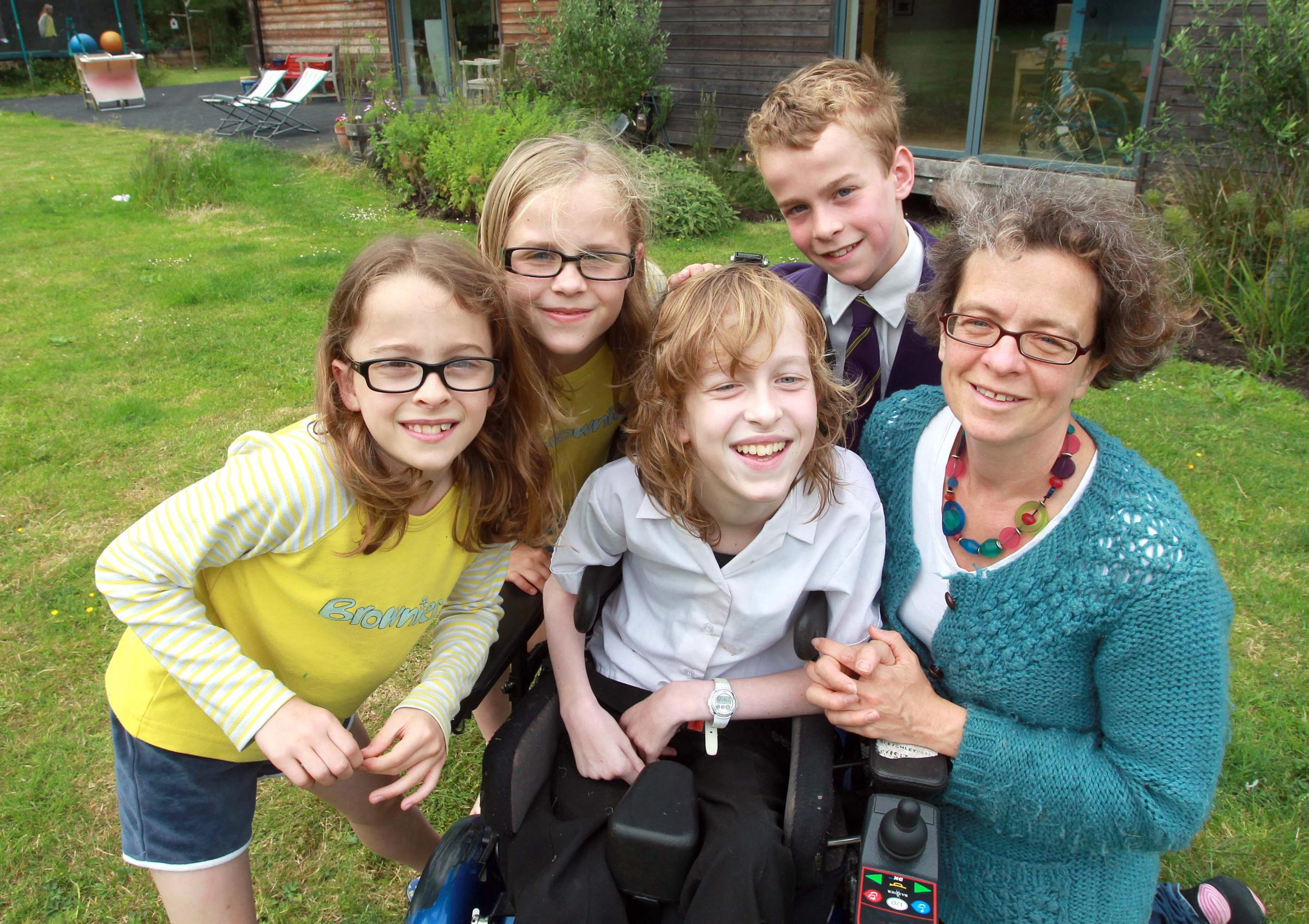 Philippa with her sisters Samantha (front) and Georgina, brother Matthew and mum Caroline