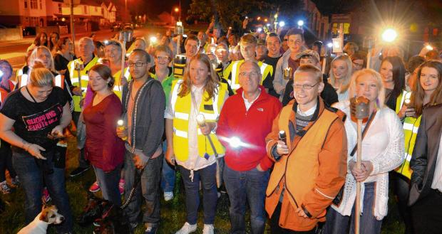 Gazette: In pictures: Hundreds take to streets for torch-lit procession