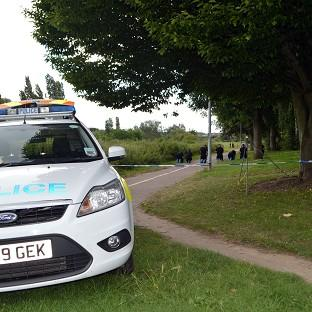 Gazette: Police search the scene at Salary Brook Trail in Colchester , Essex, where Nahid Almanea was attacked