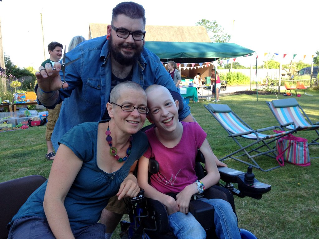 Caroline and Philippa Smith with barber Daryl