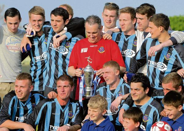 Gazette: All change - Keith Wilson (centre), pictured celebrating trophy success with Burnham Ramblers, is the new Heybridge Swifts manager.