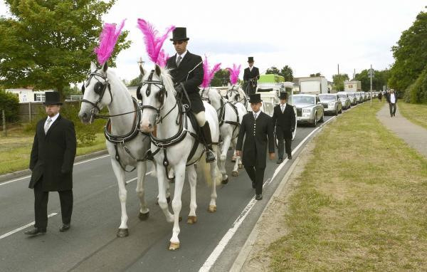 Hundreds of friends and family pay respects at lavish send-off