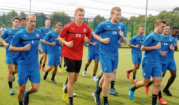 New recruit - Chris Lewington (red top) is one of four new signings Colchester United have made this summer. Picture: SEANA HUGHES (CO94212-05)