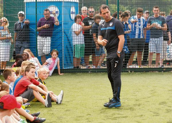 Pointing the way - U's boss Joe Dunne passes on some advice to youngsters at Colchester United's Open Day, last Sunday. Picture: SEANA HUGHES (CO94212-08)