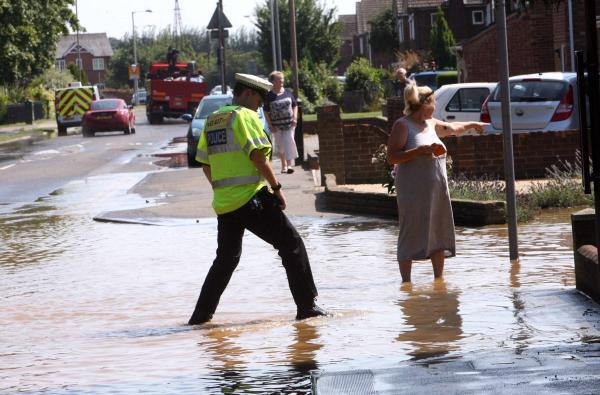 Flooding after pipe bursts in Stanway