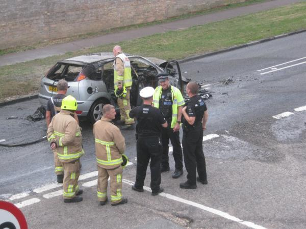 Heroic officers praised for rescuing woman moments before car fire
