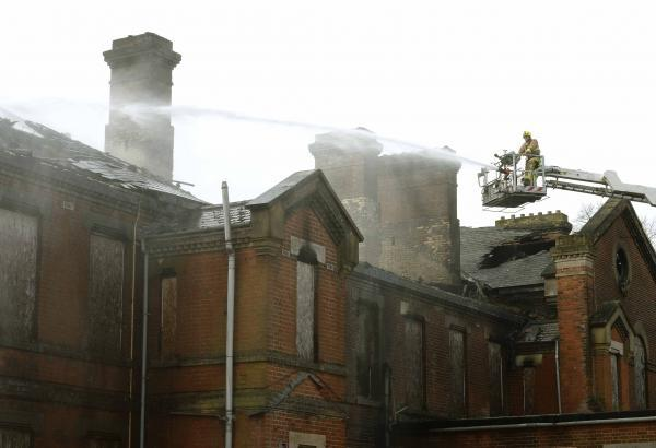 Firefighters stopping the blaze at the Sergeants' Mess building in Colchester