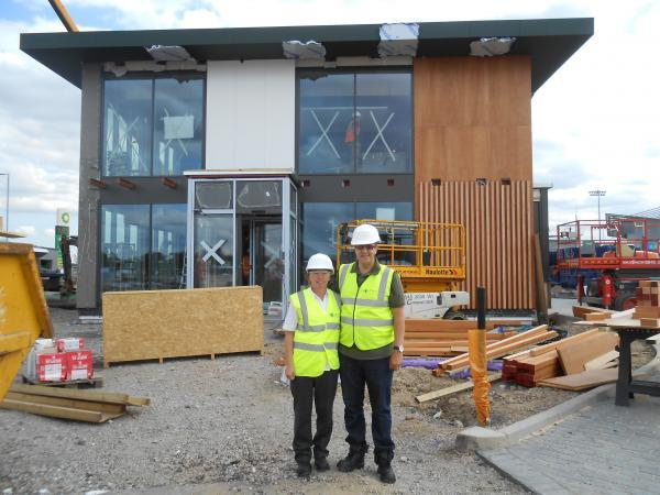 Franchisee Craig Newnes and business manager Georgina Corbett outside the new restaurant