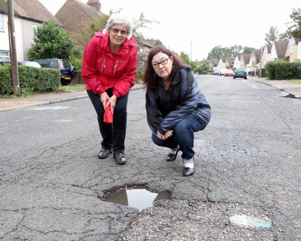 Potholes are being filled in...after a 40-year wait
